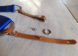 Connect through leather loop or with ring